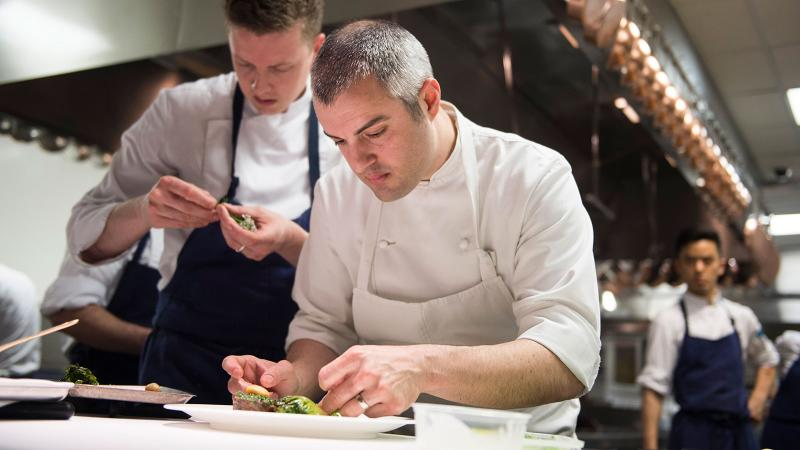 Chef Abram Bissell plates a dish at the Modern