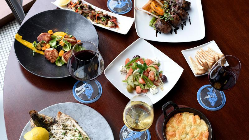 A spread of food at Ouzo Bay in Houston