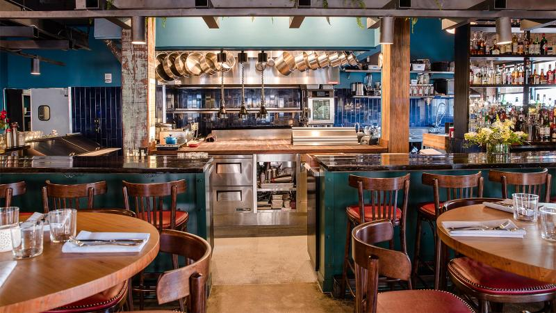 Bywater American Bistro's dining room and open kitchen
