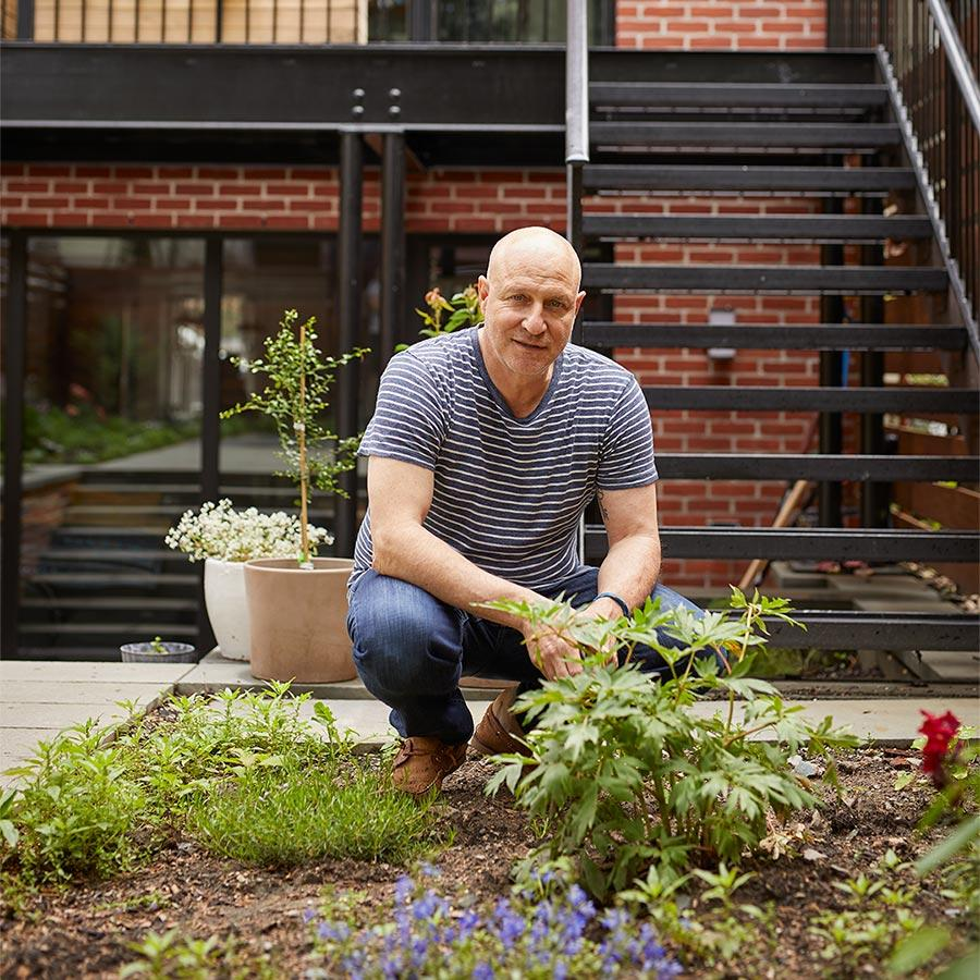 Tom Colicchio outside of his building, in his herb and flower garden. Photo by Ty Cole