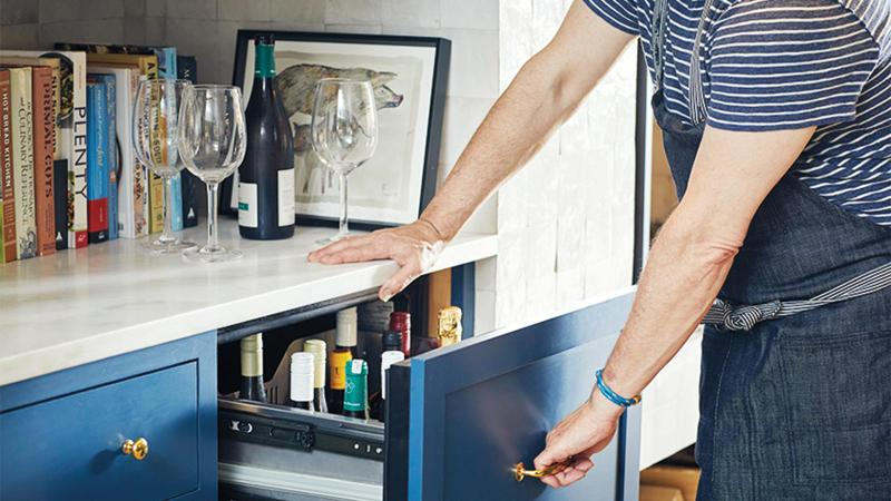 Pull-out drawers, with temperature control, store the ready-to-drink wine collection. Photo by Ty Cole
