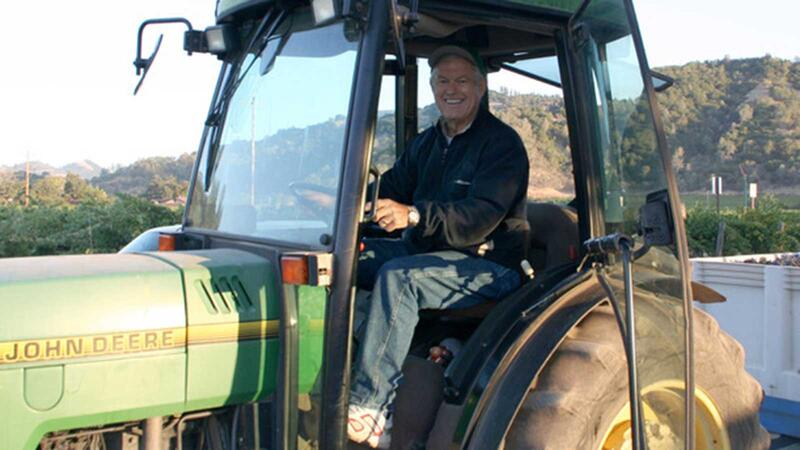 Dick Vermeil on a tractor