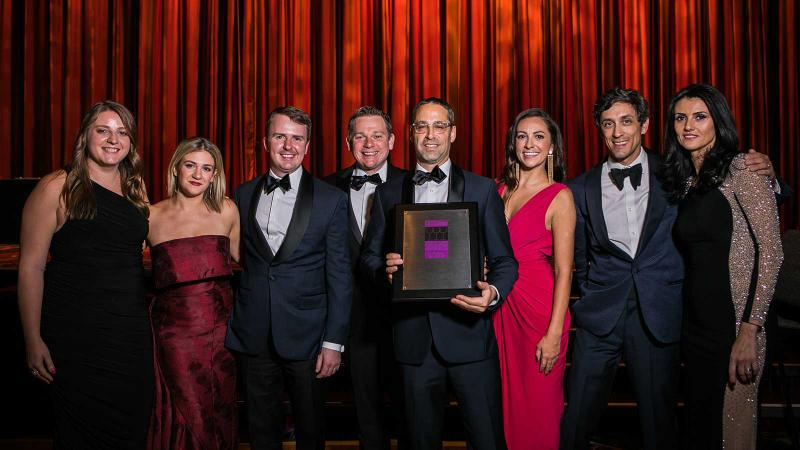 Wine director John Slover (holding plaque) and his team accept the Grand Award for the Pool in New York