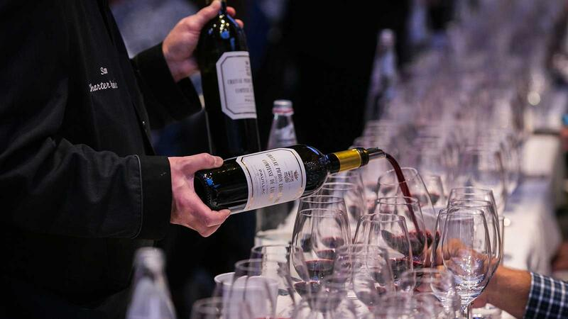 A bottle of Pichon Lalande is poured for a Wine Experience guest