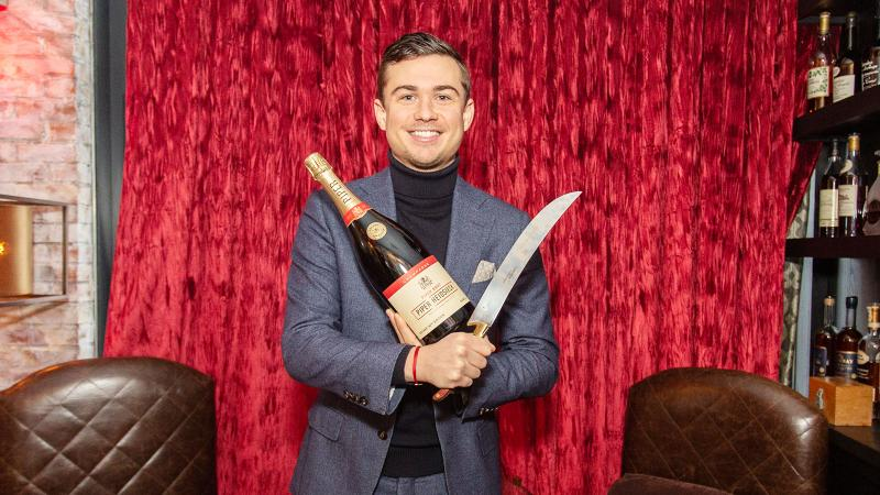 Jonathan Boulangeat with Piper-Heidsieck bottle and saber