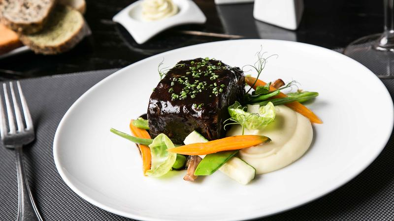 Short rib, mashed potato and vegetables at Eloise Chic Cuisine