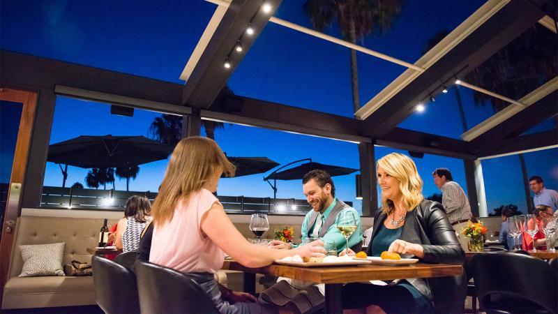 Guests dining outdoors at Michael's on Naples
