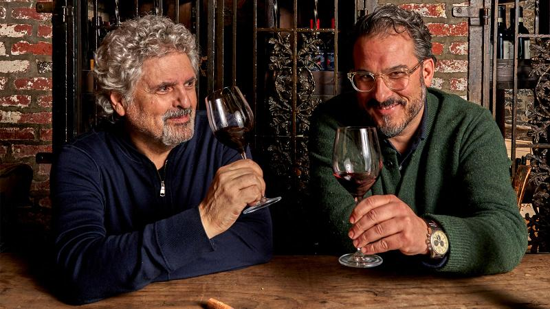 Roberto Paris and David Giuliano holding glasses of red wine