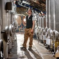 Johannes Hasselbach stands in the Gunderloch cellars. Few people can work in the small space right now with social distancing rules.