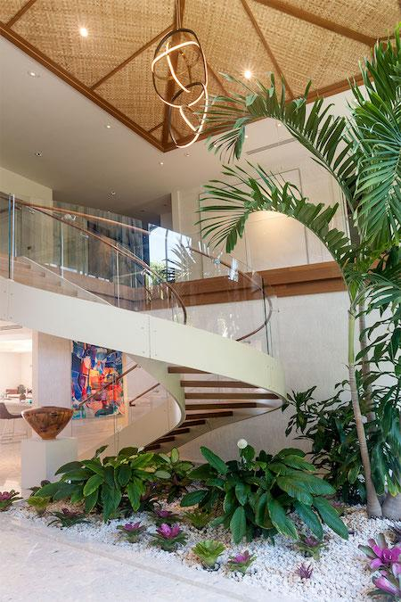 Entryway with palm tree, rock garden and spiral staircase