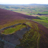 """The Tap O' Noth site was a splendid """"city"""" on a hill. Right, the Bullion Stone is a rare depiction of Pictish thirst-quenching (from a cow's horn), though it postdates the founding of Tap O' Noth.Surprising Find Suggests Medieval Scotland Actually Land of Wine-Sipping Big-City Folk"""