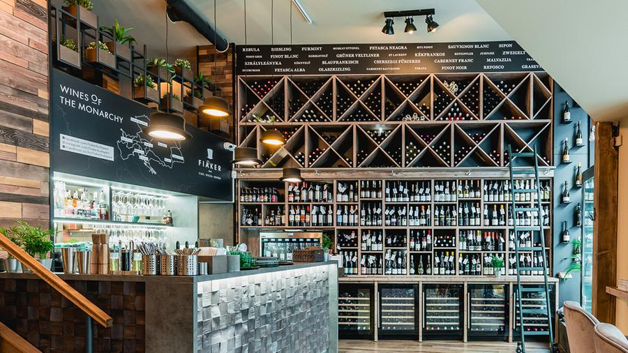 Bar and wine bottle display area at Fiaker restaurant in Hungary