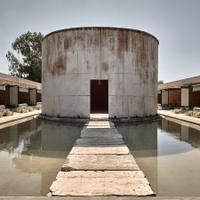 Enjoy your chai! The wine tanks–turned-guest rooms flank both sides of a massive central vat.Suite Wine? Abandoned Winery Ruins Reborn as Luxe Hotel