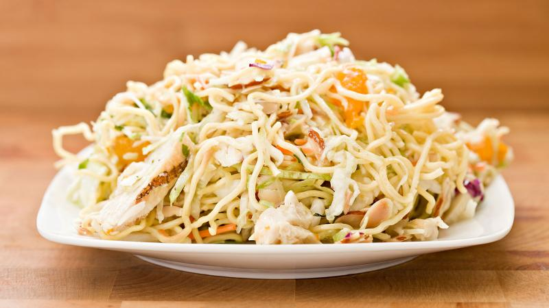 Mixed salad of Napa cabbage, coleslaw mix, shredded chicken, toasted ramen noodles, toasted almonds and mandarin orange slices.
