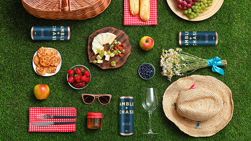 Food, cans of wine and other items laid out for a picnic