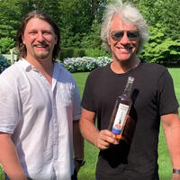 Jon Bon Jovi (right) and his son, Jesse Bongiovi, are tuning up and pouring up for Friday's festivities.Jon Bon Jovi Is Playing at Your House to Raise COVID Relief Money with His Rosé