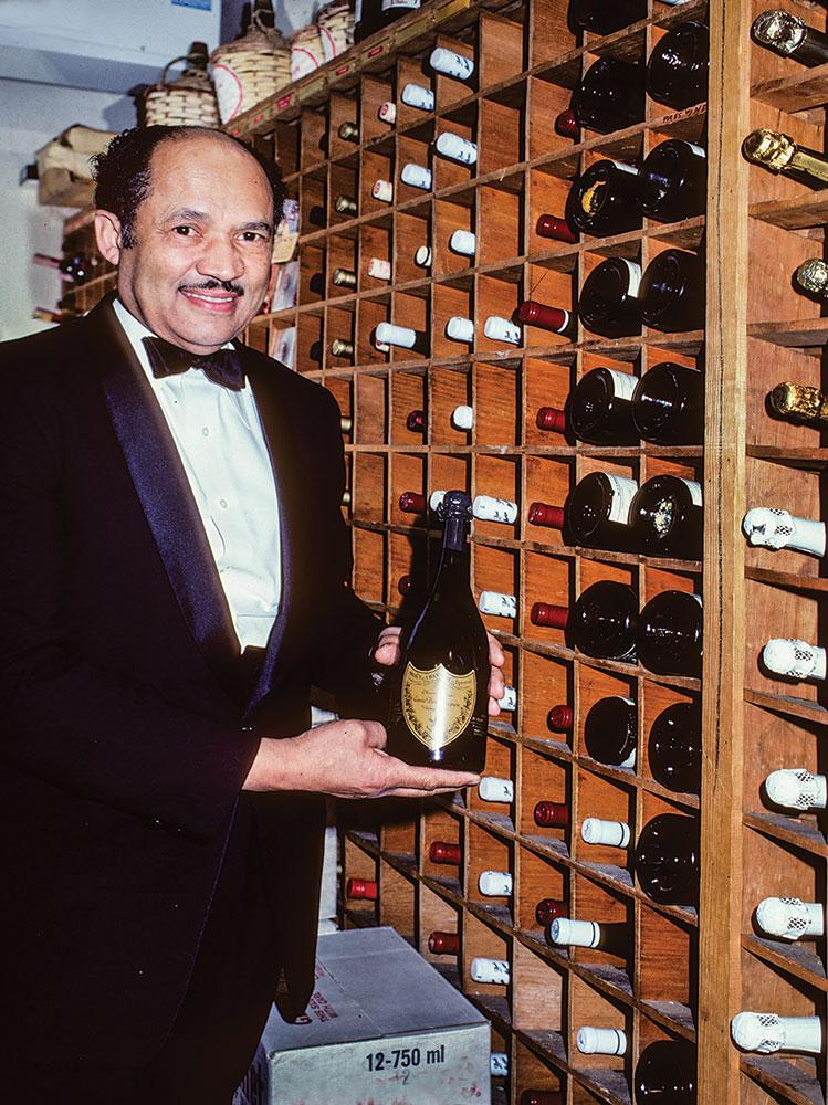 White House head butler Eugene Allen in the 300-bottle White House cellar during the Reagan administration; author Fred Ryan was able to track down never-before-published looks inside the cellar.