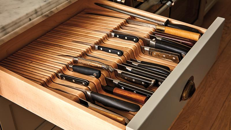 Storage drawer with individual slots for professional chef knives