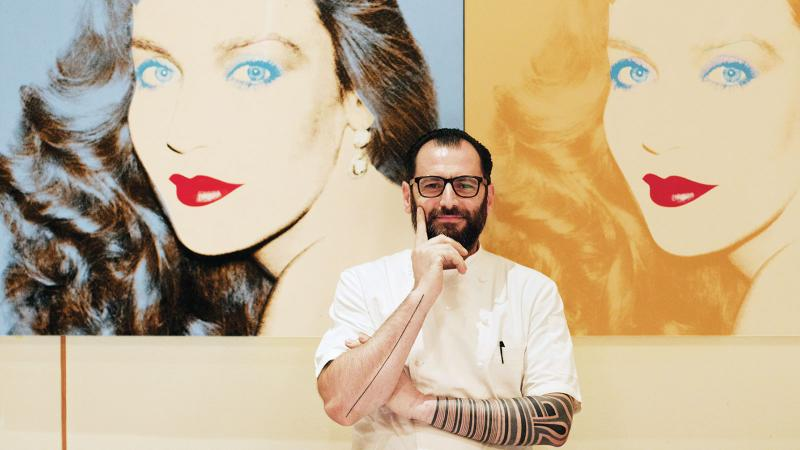 Portrait of chef Iacopo Falai in front of an artwork