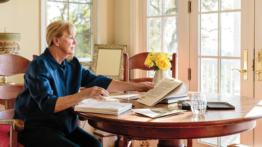 Robin Lail, shown here at work on her forthcoming memoir, has recently had time to reflect on the forces that shaped her trajectory as a guiding light of Napa Valley.